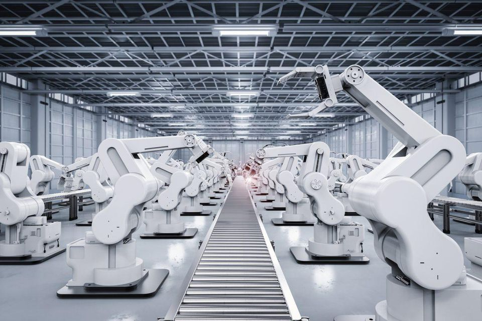 robot arms on a factory floor